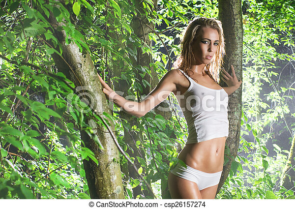 Young and wild woman in jungle - csp26157274