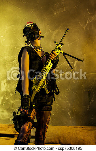 Young army woman holding an assault rifle - csp75308195