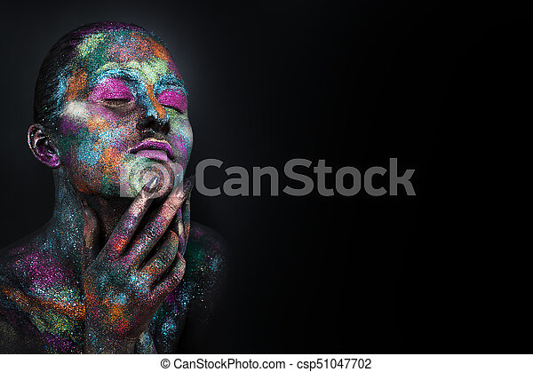 Young Artistic Woman In Black Paint And Colourful Powder Glowing Dark Makeup Creative Body Art On The Theme Of Space And