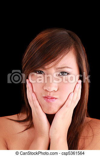 Young Asian American person woman making a face - csp5361564