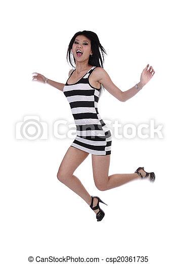 Young Asian American Woman Jumping Dress Joy - csp20361735
