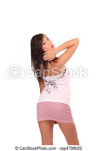 Young asian american woman pink skirt behind - csp4799022