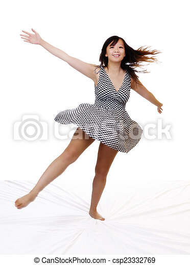Young Asian American Woman Spinning In Dress - csp23332769