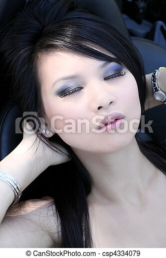 Young Asian American woman with eyes closed portrait - csp4334079