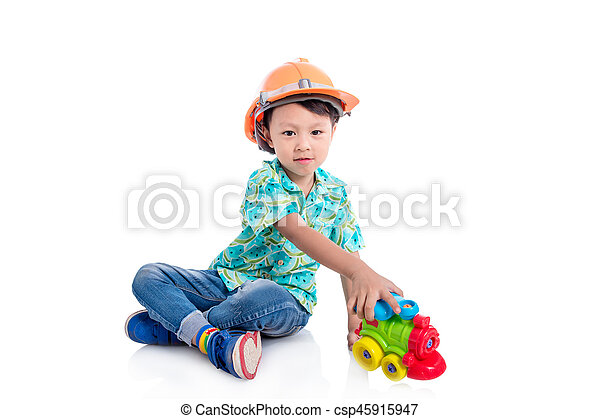 Young asian boy playing toy on the floor - csp45915947