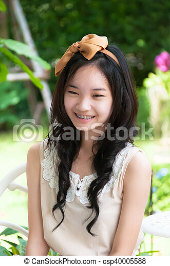 young asian chinese woman smiling - csp40005588
