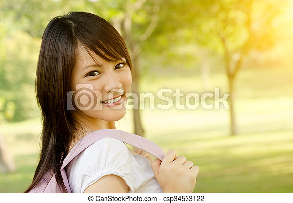 Young Asian college girl student smiling - csp34533122