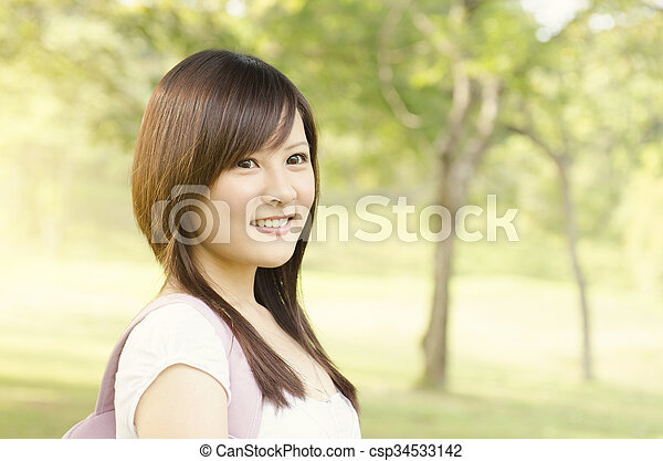 Young Asian girl student smiling - csp34533142