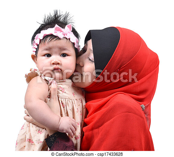young asian muslim mother kissing her cute baby girl isolated on