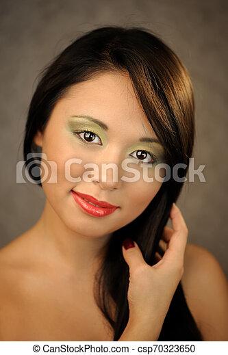 Young asian smiling woman - csp70323650