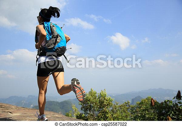 young asian woman hiker running - csp25587022