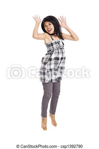 Young asian woman jumping for joy - csp1392790
