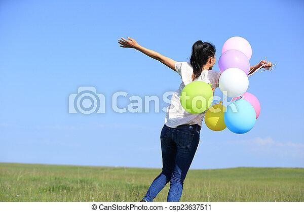 young asian woman jumping - csp23637511