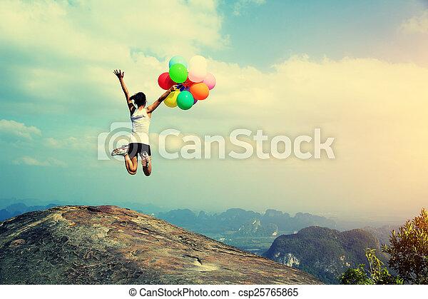 young asian woman jumping - csp25765865