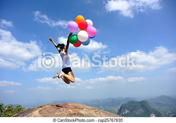 young asian woman jumping - csp25767630