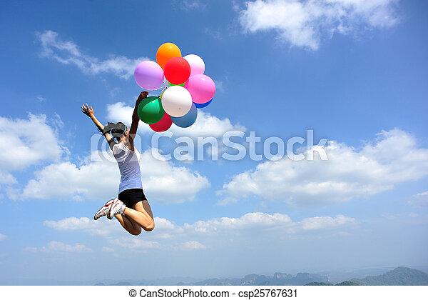 young asian woman jumping - csp25767631