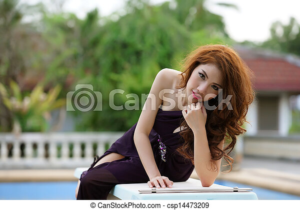 Young Asian woman outdoor portrait - csp14473209