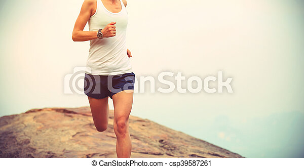 young asian woman runner running on mountain peak - csp39587261
