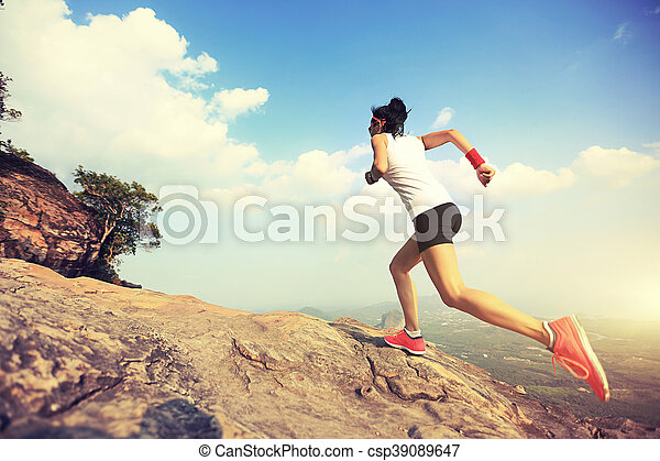 young asian woman runner running on mountain peak - csp39089647