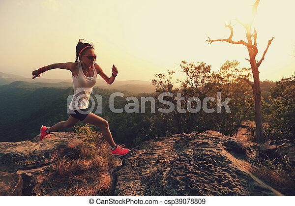 young asian woman runner running on mountain peak - csp39078809