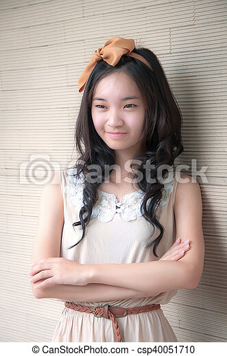 young asian woman smiling with arms crossed - csp40051710