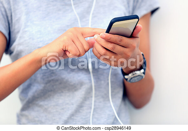 young asian woman use smartphone at city - csp28946149