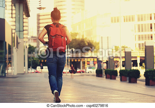 young asian woman walking on city street - csp40279816