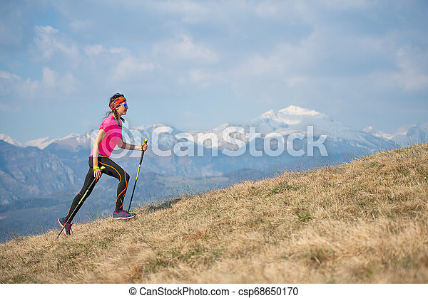 Young athlete running in the mountains and skyrunning during a workout - csp68650170