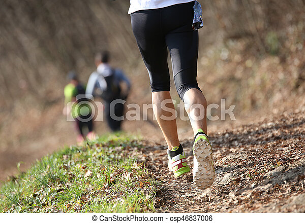 young athlete runs on the trail on mountains during a cross-coun - csp46837006