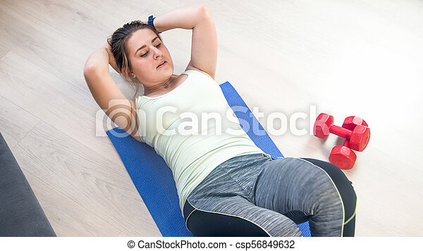 Young Athletic Woman Doing Crunches On Wooden Floor Athletic