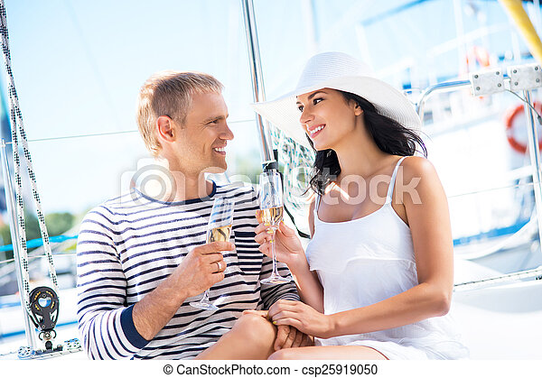 Young, attractive and rich couple have a party on a luxury boat - csp25919050