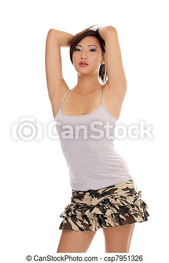 Young attractive Asian American woman tee shirt skirt - csp7951326