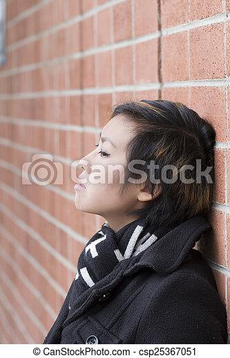Young Attractive Asian American Woman Brick Wall - csp25367051