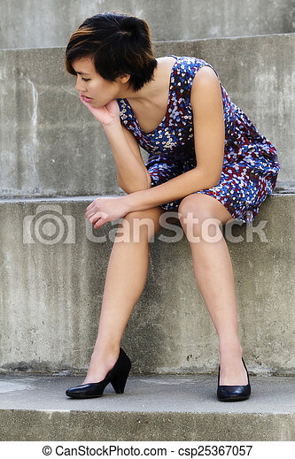 Young Attractive Asian American Woman Sitting Steps - csp25367057