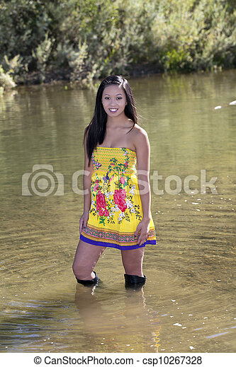 Young Attractive Asian American Woman Yellow Dress - csp10267328