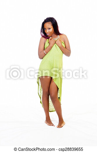 Young Attractive Black Woman Standing Holding Up Green Dress - csp28839655