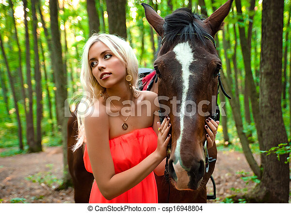 young attractive girl with a horse - csp16948804