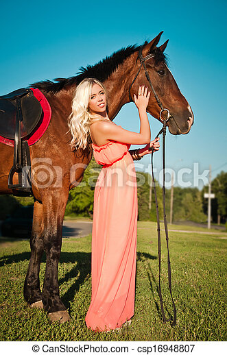 young attractive girl with a horse - csp16948807