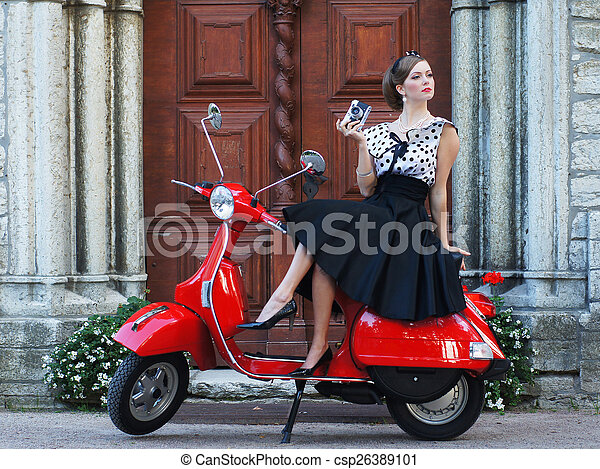 Young attractive girl with a scooter - csp26389101