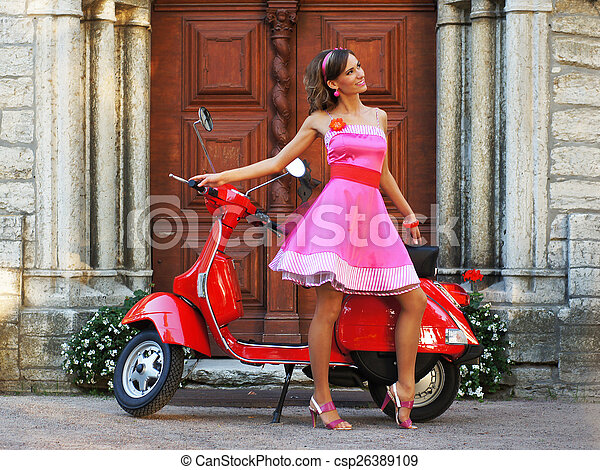 Young attractive girl with a scooter - csp26389109