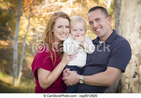Young Attractive Parents and Child Portrait - csp8012820
