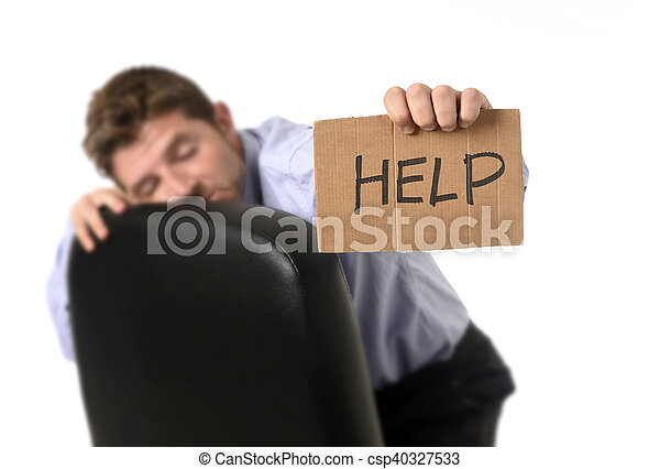 young attractive tired and wasted businessman sitting on office chair  asking for help in stress