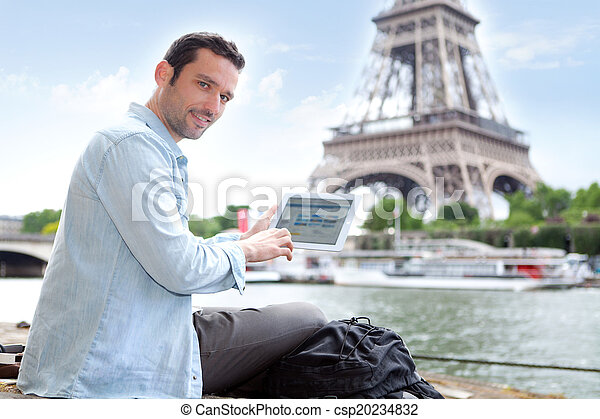 Young attractive tourist using tablet in Paris - csp20234832