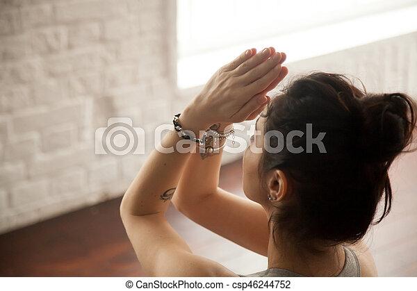 young attractive woman making namaste gesture loft studio