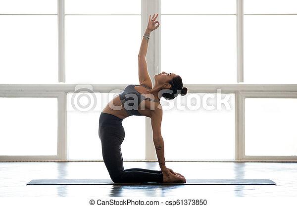 young attractive yogi woman practicing yoga doing