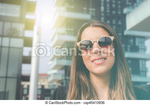 young authentic business woman in the city for a buisness trip - csp45410936