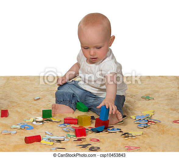 Young baby playing with educational toys - csp10453843