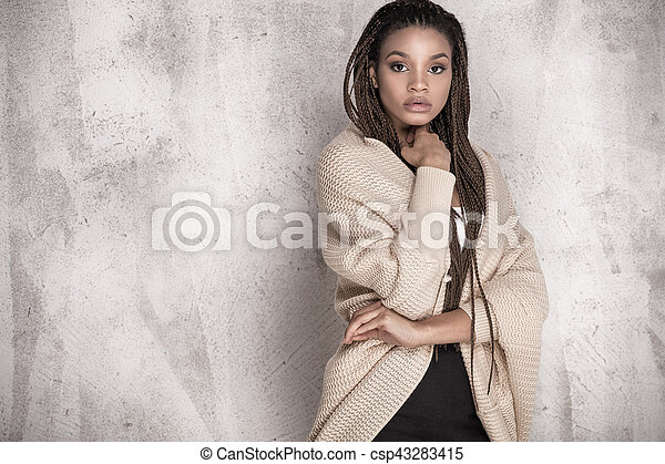 Young beautiful african american woman posing. - csp43283415