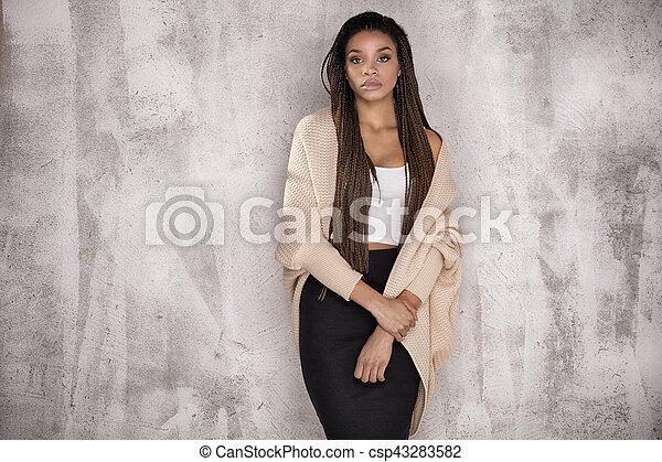 Young beautiful african american woman posing. - csp43283582