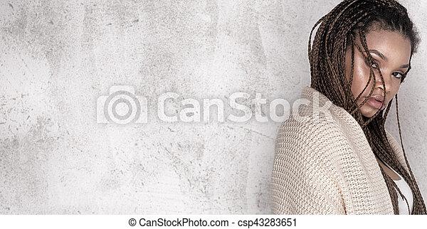 Young beautiful african american woman posing. - csp43283651